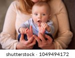the mother embarce  her son ... | Shutterstock . vector #1049494172
