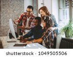 young group of designers... | Shutterstock . vector #1049505506