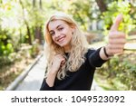 young beautiful girl student... | Shutterstock . vector #1049523092