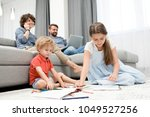 ordinary day of large family ... | Shutterstock . vector #1049527256