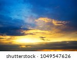 storm clouds at sunset in rays... | Shutterstock . vector #1049547626