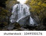 thap lan waterfall  prachin...   Shutterstock . vector #1049550176