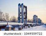 overground heat pipes. pipeline ... | Shutterstock . vector #1049559722