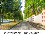 vanishing point of tram tracks... | Shutterstock . vector #1049563052