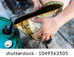 the mechanic is pouring the... | Shutterstock . vector #1049563505