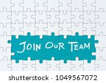 Small photo of Job recruiting advertisement represented by 'JOIN OUR TEAM' texts on the jigsaw puzzle board. Rows of jigsaw pieces are removed appealing blue green background - metaphor to represent hiring positions