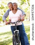 senior  couple cycling in park | Shutterstock . vector #104957336