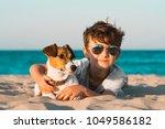 happy 8 year old boy hugging... | Shutterstock . vector #1049586182