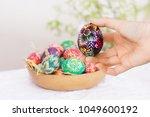 girl's hand with easter egg. in ... | Shutterstock . vector #1049600192