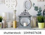 candles  a fan near the photo... | Shutterstock . vector #1049607638