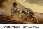 two astronauts collect soils... | Shutterstock . vector #1049625062