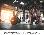 muscular athletes training in a ... | Shutterstock . vector #1049628212