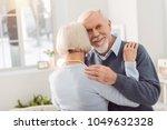 happy husband. joyful elderly...   Shutterstock . vector #1049632328