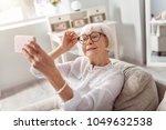 perfect mood. cheerful senior... | Shutterstock . vector #1049632538