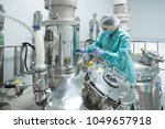 pharmaceutical factory woman... | Shutterstock . vector #1049657918