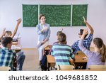 group of students listening to... | Shutterstock . vector #1049681852
