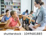 group of students listening to... | Shutterstock . vector #1049681885