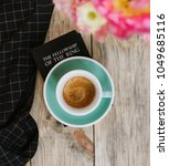 """Small photo of VORONEZH/RUSSIA-03.19.2018: Delicious fresh espresso coffee with a beautiful crema in ceramic Acme cup, standing on the """"The Lord of the Rings"""" book by J.R.R. Tolkien on the wooden table background"""
