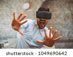 man have fun with virtual... | Shutterstock . vector #1049690642