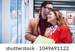 shopping time. young couple... | Shutterstock . vector #1049691122