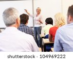 senior tutor teaching class | Shutterstock . vector #104969222