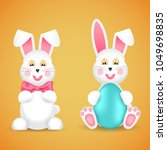 two funny easter bunnies with a ... | Shutterstock .eps vector #1049698835