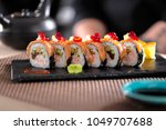 sushi rolls served in a... | Shutterstock . vector #1049707688