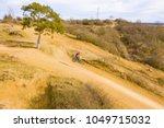 aerial view of racing motocross ... | Shutterstock . vector #1049715032