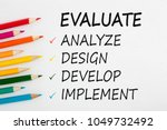 evaluate written on a white... | Shutterstock . vector #1049732492