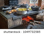 food heated on a wood burning... | Shutterstock . vector #1049732585