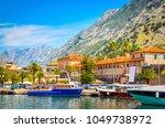 port in old town kotor ... | Shutterstock . vector #1049738972