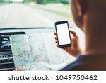 hipster looking on navigation... | Shutterstock . vector #1049750462