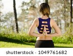 young woman from behind doing... | Shutterstock . vector #1049761682