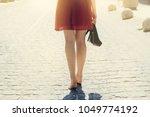 pretty lady in red dress... | Shutterstock . vector #1049774192