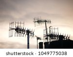television aerials on roof at... | Shutterstock . vector #1049775038