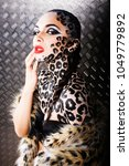 young sexy woman with leopard... | Shutterstock . vector #1049779892