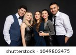 Stock photo celebration people and holiday style concept happy friends in party clothes over black background 1049803475