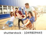group of happy young people... | Shutterstock . vector #1049809445