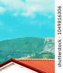 red roof of a alpine house on a ... | Shutterstock . vector #1049816306