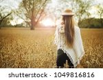 young woman boho style holding...   Shutterstock . vector #1049816816