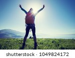 happy woman hiker on beautiful... | Shutterstock . vector #1049824172