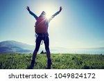happy woman hiker on beautiful... | Shutterstock . vector #1049824172