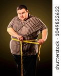 man belly fat with tape measure ... | Shutterstock . vector #1049832632