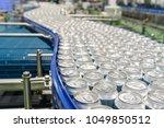 conveyor line carrying... | Shutterstock . vector #1049850512
