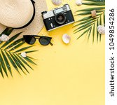 traveler accessories on yellow... | Shutterstock . vector #1049854286
