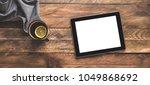 digital tablet ipad and a tea... | Shutterstock . vector #1049868692