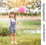 portrait happy little girl with ... | Shutterstock . vector #1049895098