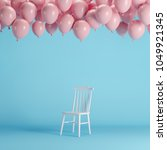 white chair with floating pink... | Shutterstock . vector #1049921345