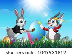 two easter bunnies painting an... | Shutterstock .eps vector #1049931812