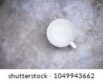 white cup with water on a light ... | Shutterstock . vector #1049943662